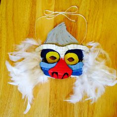 """DIY """"The Lion King"""" Rafiki Mask Materials: Card Board, Paints, Hot Glue Gun, Feathers, and String"""