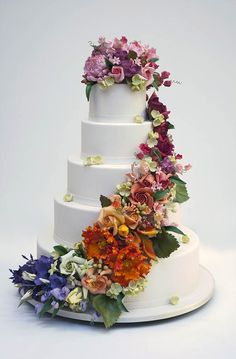 Another five tier Ron Ben Israel wedding cake with a classic flower cascade without the gold appliqués.