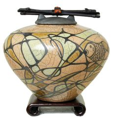 Dodero Studio Ceramics offers Raku art pottery, custom Raku ceramic pottery, urns for ashes, custom cremation urns, cache pots, orchid planters & pet urns.