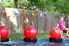 Wipeout! obstacle course- inflatable water slide, added a mini trampoline and our own big red balls (yoga balls that sat on tires), followed by a baby pool filled with plenty of bubbles and plastic balls, and ended the course with pool noodles grounded in pots to create an in and out weave. The entire course was set up on plastic tarps which were wet and soapy to make things even more fun!