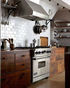 Stained cabinets with white subway tile