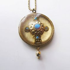 Cross inlaid in round antique brass bezel by sassonorly on Etsy, $90.00