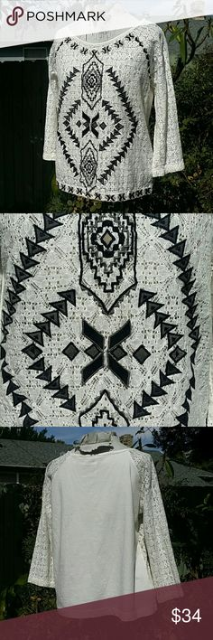 Free People White Embroidered Lace Blouse M Striking black embroidery on front of lace top Has a tribal feel to it Soft cotton back, solid white 3/4 sleeves, loose fit, slightly cropped length  In good condition  Made by Free People Free People Tops Blouses