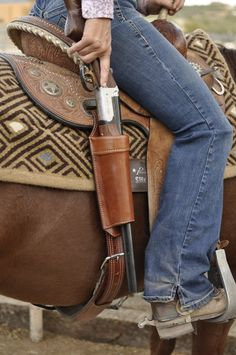Designed to fit both a lever action rifle, carbine or shotgun, this Long Gun Scabbard mounts directly to the rear rigging dee of a western saddle, and is all one piece for easy installation or removal. Gun Holster, Leather Holster, Equestrian Boots, Equestrian Outfits, Western Horse Tack, Western Saddles, Cowboy Gear, Horse Accessories, Horse Gear