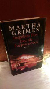 Martha Grimes – Inspektor Jury lässt die Puppen tanzen
