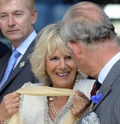Duchess of Cornwall wearing the late Queen Mother's 3 strand pearl necklace.