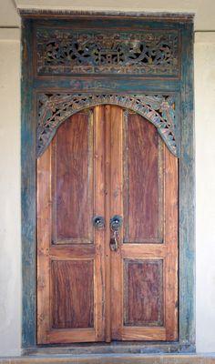 Javanese teak wood door; by Adrienne O.