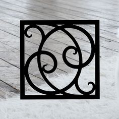 This decorative Wrought Iron Wall Art piece, Style 215, features a Geometric square silhouette that will add beauty and character to any wall or surface. It is coated in one of the most long-lasting finishes available - a flat black baked-on powder coated finish that will last for many years.