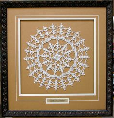 """Doily framed with a name plate. Great to remember why this piece is significant. Love how the """"V"""" groove pulls it all together and how the mat is set up to add depth. Framed by Frameworks of Utah."""