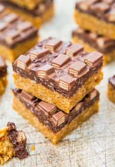 Chocolate Peanut Butter Kit Kat Crunch Bars  Easy and quick racipe for this no-bake bar. Ideal for surprise guest or when you are limited with time. They're like a homemade peanut buttery Crunch Bar topped with Kit Kats, and they're worth every empty calorie