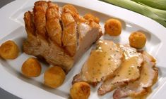 Receta de Lomo de cerdo asado con bolitas de garbanzos