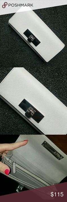 Michael Kors Wallet Excellent condition. New but tags are not attached or included.  Lots of space and compartments in the inside. Room for lots of ID and credit cards.  Definitely a must have.   ✔I'm a Posh Ambassador ✔Top Rated Seller✔I ship out same day or next day if ordered after 3pm Michael Kors Bags Wallets