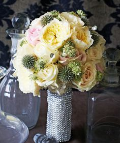 For the glamorous bride, bouquets adorned with opulent trims are perfect for decadent celebrations. Bouquet, $600, from Fiore Dorato. http://www.herworldplus.com/weddings/updates/fab-bridal-bouquet-ideas #herworldbrides #bouquet #brides #bridal #weddings #flowers