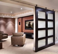 What about this idea to cover closet then move to cover the window in media room just an idea Retreat - modern - media room - ottawa - by Handwerk Interiors Love the doors!