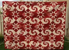 snail trail quilt | Red & White Snail Trail With Star Quilt. This quilt is made with ...