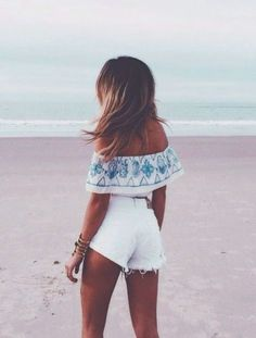 Beach attire: all white with a touch of blue detail.