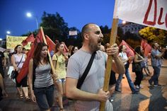 Demonstrators march during an anti-austerity rally in the northern Greek port city of Thessaloniki, Wednesday, July 15, 2015. Greece's prime minister was fighting to keep his government intact in the face of outrage over an austerity bill that parliament must pass Wednesday night if the country is to start negotiations on a new bailout and avoid financial collapse. (AP Photo/Giannis Papanikos)