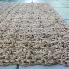 Crocheted jute rug using three strands of three ply jute twine. I see this in my future of future stuff.......D.