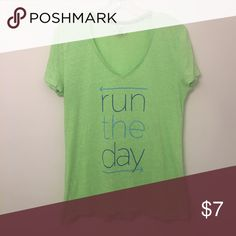 "UA Graphic T Says ""Run the Day."" Fitted. Under Armour Tops Tees - Short Sleeve"