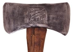 """A rare """"Feather edge"""" embossed axe by the Monroe Hardware Company, Monroe, Louisiana. double bit type."""
