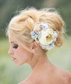 Another 25 Bridal Hairstyles & Wedding Updos | Confetti Daydreams - A perfectly messy updo with a pastel flower arrangement as an accent that adds a pretty and feminine touch.