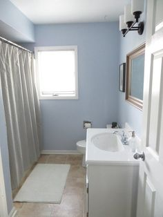"""Here's the budget breakdown:  counter top — Lowes — $99 faucet — Lowes — $39 mirror — IKEA — $49 paint — Lowes — $27 grout renewal — Home Depot — $12 caulk — Lowes — $6 bath mat — IKEA — $10 & After: The Under $250 """"Work With What We've Got"""" Bathroom Refresh — Renovation Project"""