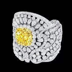 An exceptionally rare 76.31ct Natural Fancy Yellow cushion cut Multi Shape diamond bracelet by Graff Diamonds