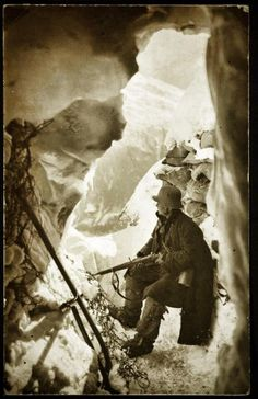 Austrian soldier sitting in front of a dugout in the Italian front, World War I.