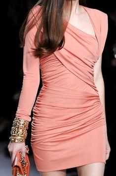 Pretty coral dress, gold bangles.