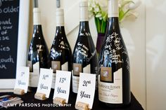 Sign champagne bottles to be opened on an anniversary!