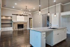 524 Ellison Trace Argyle TX 76226 #dreamhome #interior #interiors #interiordesign #dfw #dallas #greenhome #customhome #architecture #kitchen #dreamkitchen #kitchenisland #livingroom #openfloorplan