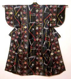 Black meisen kimono with abstract red, white, yellow designs similar to  Okinawan kasuri