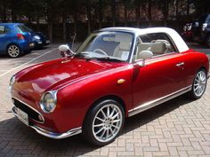 Nissan Figaro, custom paint job in Candy Apple Red. I'm gonna own one of these babies if it kills me.
