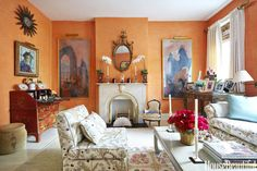 When designer Justine Cushing moved in her New York apartment in 1970, she had the living room walls painted a custom orange — a color she has never considered changing. It's a dynamic backdrop for artworks by her grandfather, Howard Gardiner Cushing, and a red lacquer chinoiserie desk that is a family heirloom.
