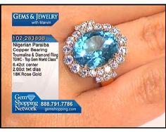 Nigerian Paraiba tourmaline ring - 6.4 carat paraiba tourmaline ring with 2 carats of diamonds setting off the center stone, all in 18k gold. #tourmaline #ladiesrings