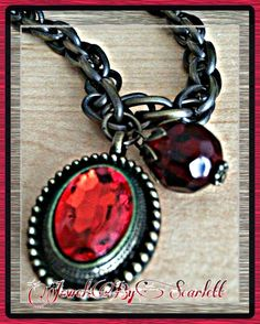 Beautiful Vintage style necklace with an amazing ruby pendant accented by a unique cranberry colored bead. It is set on a gunmetal chain. #JewelsByScarlett #ruby #cranberrydrop #gunmetal #necklace #vintage | Shop this product here: http://spreesy.com/JewelsByScarlett/29 | Shop all of our products at http://spreesy.com/JewelsByScarlett    | Pinterest selling powered by Spreesy.com
