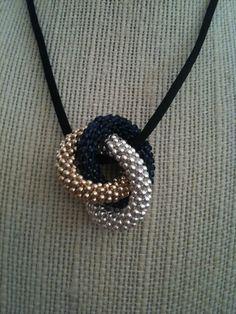 Items similar to Anne's Triple Infinity Bead Crochet Pendant on Etsy