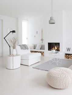 Living room in white with natural, grey and beige accents.