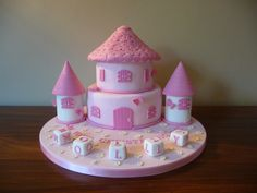 """This is the third run for my fairy castle cake design, for Molly's christening. The cake consists of an 8"""" chocolate mudcake and a 6"""" vanilla sponge. The side towers are made from rice crispy marshmallow treats. #fairycastle"""
