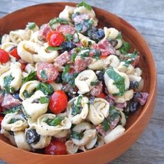 Tortellini Salad -   A meal in one salad, with cheese tortellini, salami, fresh basil, tomatoes, olives and spinach.