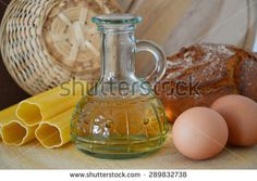bottle with oil, bread, pasta, eggs  - stock photo