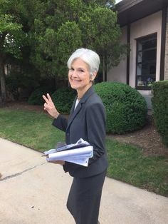"""DrJillStein being escorted off the campus of #Hofstra: """"This is what democracy looks like."""" #debatenight #Debates2016 ...  lancegould @lancegould"""
