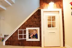 This DIY playhouse is a smart idea for unused under-the-stairs space. via Pam Baldwin
