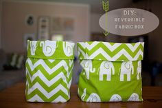 Really cute fabric 'boxes' that are also reversible.  Seems really easy to do and would be super cute to make to hold a gift for a baby shower vs. a paper bag!