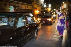 A Geisha bows to those departing in a taxi before making her own way home