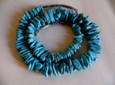 A large-scale turquoise nugget necklace,    probably made at Santo Domingo Pueblo, New Mexico from 101 natural Morenci, AZ. turquoise nuggets, shell heishi and silver beads, circa 1950's-1960's <3