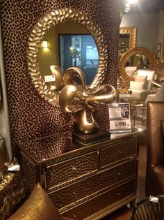 Gettin wild in High Point with our new Crosby Mirror and matching dresser. Hammered texture, champagne silver with gold toned finish create a look that can't be beat.  Howard Elliott Fall 2014 #Hpmkt