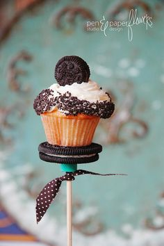 Oreos..secure the cuppy cake with a dab of royal icing so it doesn't topple off!