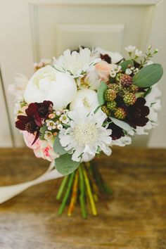 White and marsala bridal bouquet   Image by L&V Photography