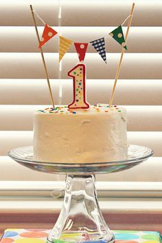 Little Inspirations: Bright 1st Birthday  Did this for Wyatt's First Birthday! So cute and so easy to make the flag banner. Candle 99cents and (Don't Hate) a store bought mini chocolate cake! Fun and easy